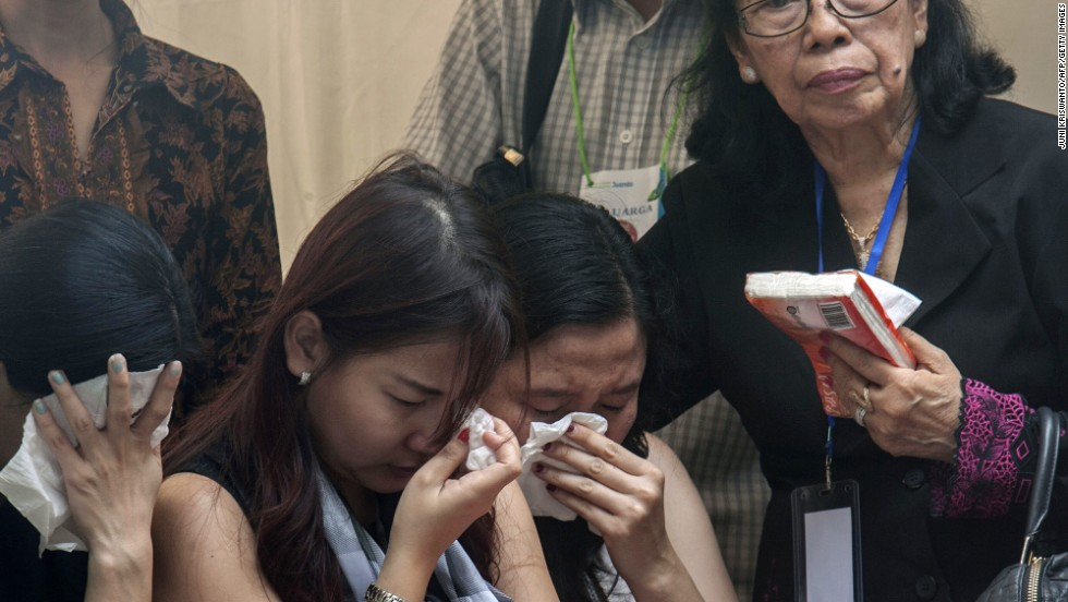 Relatives and friends grieve as they attend a ceremony January 2 in Surabaya.