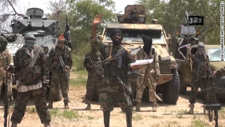"FILES) -- A screengrab taken on July 13, 2014 from a video released by the Nigerian Islamist extremist group Boko Haram and obtained by AFP shows the leader of the Nigerian Islamist extremist group Boko Haram, Abubakar Shekau (C). Boko Haram gunmen killed 48 fish vendors in Nigeria's restive Borno State, near the border with Chad, the head of the fish traders association told AFP on November 25, 2014. ""Scores of Boko Haram fighters blocked a route linking Nigeria with Chad near the fishing village of Doron Baga on the shores of Lake Chad on Thursday and killed a group of 48 fish traders on their way to Chad to buy fish, "" Abubakar Gamandi said. AFP PHOTO / BOKO HARAM"