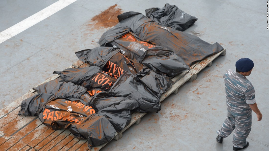 Recovered victims are placed on the deck of the Indonesian ship on January 3.