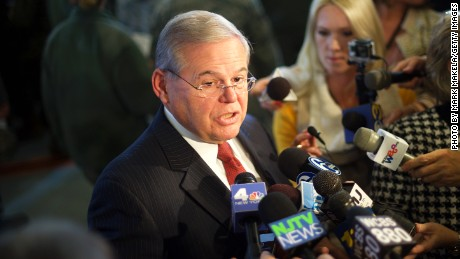 JOINT BASE MCGUIRE-DIX-LAKEHURST, NEW JERSEY - DECEMBER 15: U.S. Sen. Senator Robert Menendez addresses the media in advance of an event with U.S. President Barack Obama December 15, 2014 at Joint Base McGuire-Dix-Lakehurst, New Jersey. Obama will address the troops to thank them for their service and mark the end of the combat mission in Afghanistan. ahead of the upcoming holidays. (Photo by Mark Makela/Getty Images)
