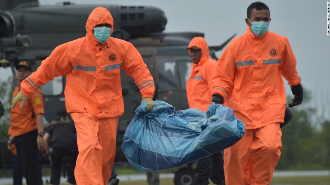 Members of an Indonesian search and rescue team carry items recovered from the search area in Pangkalan Bun on January 4.