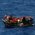 FLORIDA STRAITS - Crewmembers aboard the Coast Guard Cutter Resolute's 27-foot motor surf boat interdict a home-made boat filled with Cuban migrants to keep them from entering the United States illegally Sept. 16, 2007. All migrants interdicted by the Coast Guard are given food, water and medical attention. During a 45-day patrol, Resolute crewmembers provided humanitarian aid to more than 100 migrants. Photo by PA3 Robert Simpson.