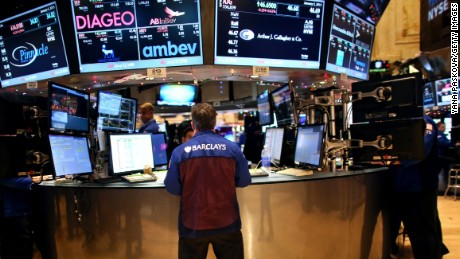 NEW YORK - JANUARY 05: Traders work on the floor of the New York Stock Exchange on January 05, 2015 in New York City. U.S. stocks fell over 330 points due to a plunge in energy stocks, as the price of oil continues to decline. (Photo by Yana Paskova/Getty Images)