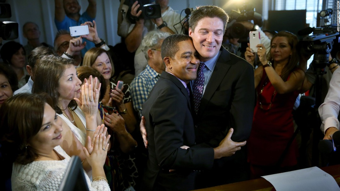 Newlyweds Jeff Delmay and Todd Delmay hug during a marriage ceremony in a Miami courtroom on Monday, January 5. Florida began allowing same-sex marriages after a judge -- following similar rulings across the nation -- struck down the state's old law banning such unions.