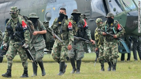 Demobilized members of the ELN (National Liberation Army) arrive in Cali, Colombia on July 16, 2013. Thirty members of the ELN surrendered with their weapons. AFP PHOTO/STR (Photo credit should read STR/AFP/Getty Images)