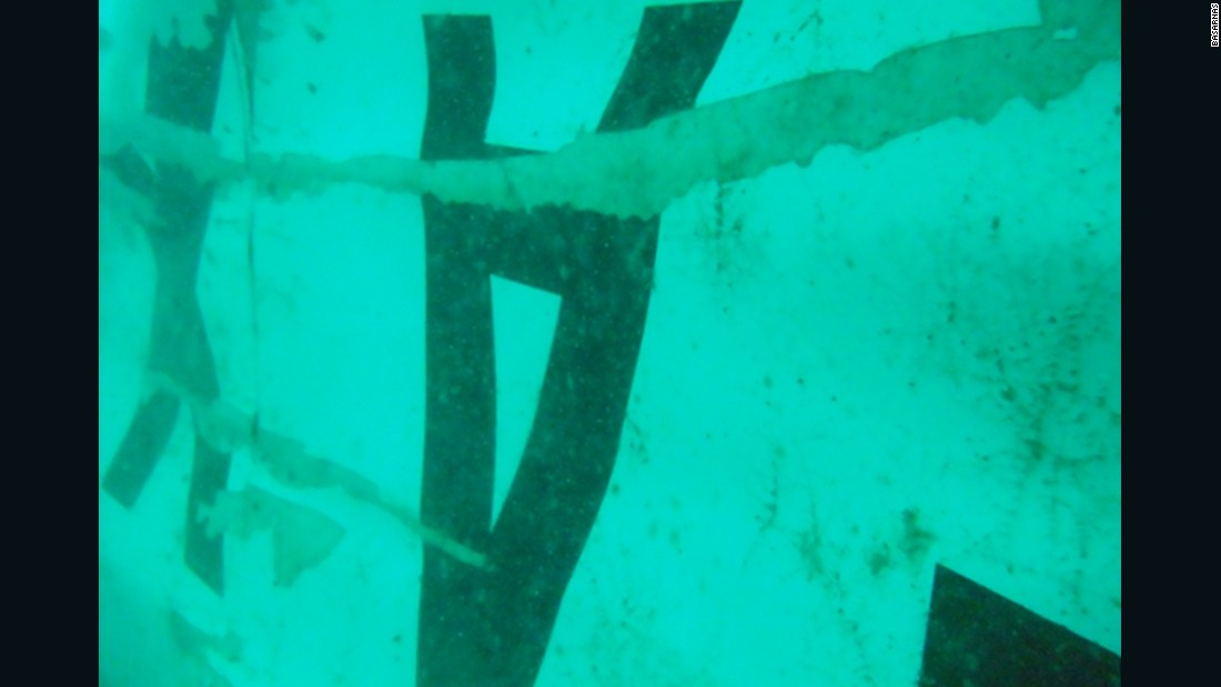 Writing could be made out, showing the AirAsia insignia and other identifying features. The find is important because the plane's flight recorders were located in the tail section.