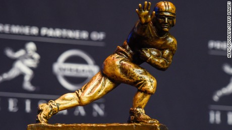 NEW YORK, NY - DECEMBER 13: The Heisman Trophy sits on a stand before a press confrence at the New York Marriott Marquis on December 13, 2014 in New York City. (Photo by Alex Goodlett/Getty Images)