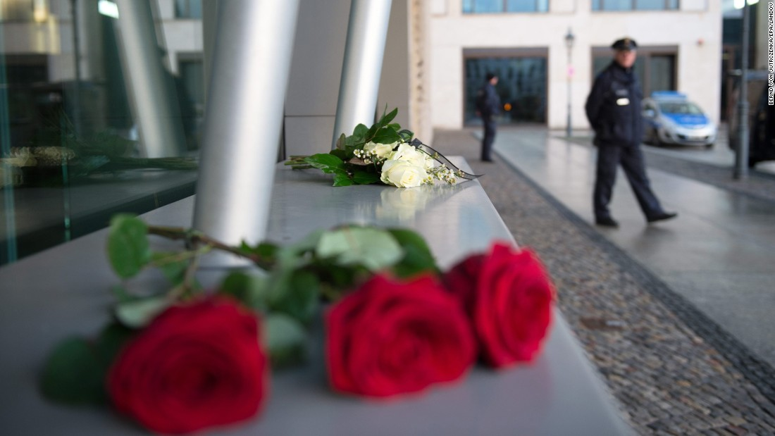 Roses are placed in front of the French Embassy in Berlin on January 7.