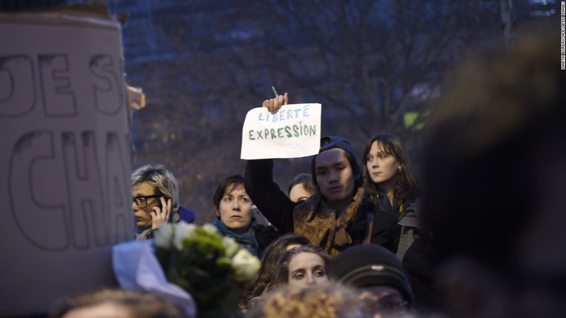 """A man holds a sign that translates to """"freedom of expression"""" during a rally in Paris on January 7."""