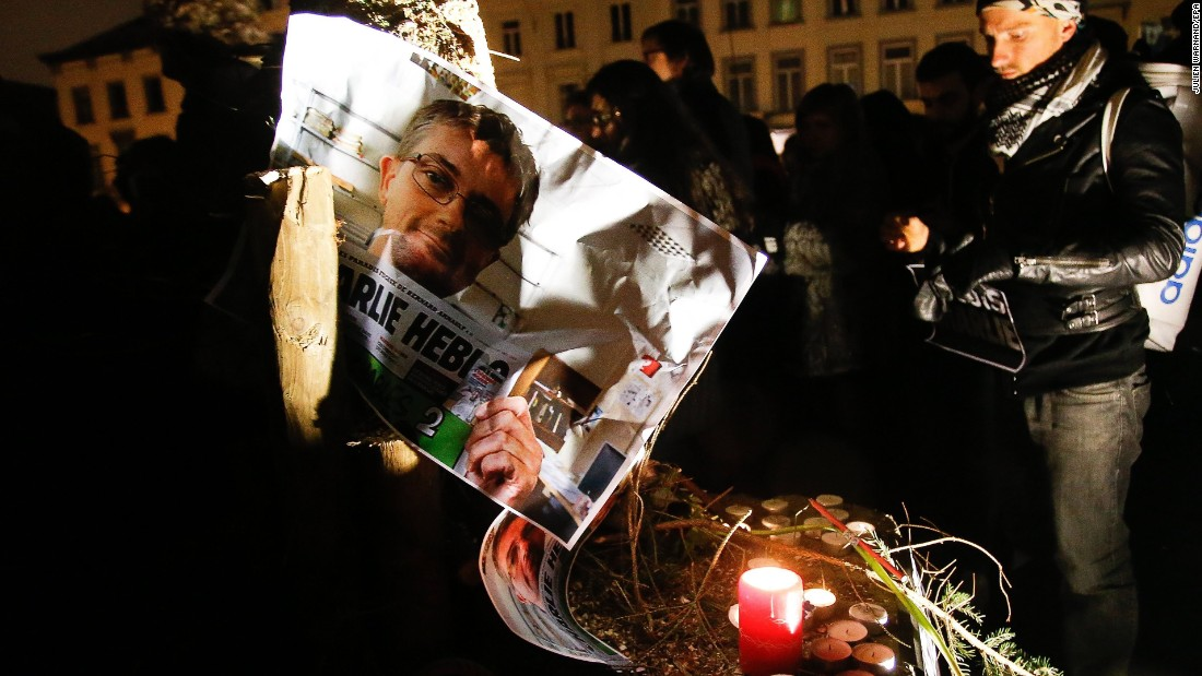 People in Brussels, Belgium, pay tribute to Charlie Hebdo editor and cartoonist Stephane Charbonnier, one of the victims of the shooting, on January 7.
