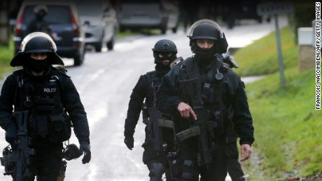 Members of GIPN and of RAID, French police special forces, are pictured in Corcy, near Villers-Cotterets, north-east of Paris, on January 8, 2015, where the two armed suspects from the attack on French satirical weekly newspaper Charlie Hebdo were spotted in a gray Clio.