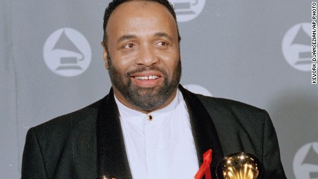 """In this March 1, 1995 file photo, Andrae Crouch displays his two Grammys backstage at the 37th annual Grammy Awards at the Shrine Auditorium in Los Angeles. Crouch won Pop-Contemporary Gospel Album for """"Mercy,"""" and Instrumental Arrangement with Vocals for """"Circle of Life,"""" with Lebo Morake and Hans Zimmer. Crouch, a legendary gospel performer, songwriter and choir director whose work graced songs by Michael Jackson and Madonna and movies such as """"The Lion King,"""" has died at age 72. His publicist says Crouch died Thursday, Jan. 8, 2015, at a hospital in Los Angeles, where he was admitted Saturday after suffering a heart attack."""