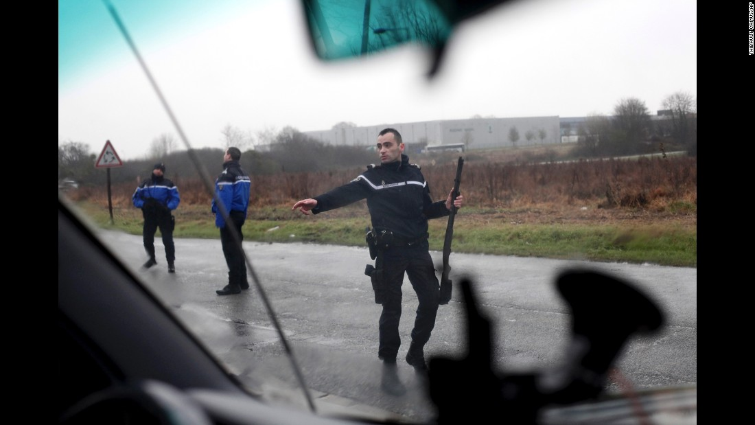 French authorities block access to a road leading to Dammartin-en-Goele on January 9.