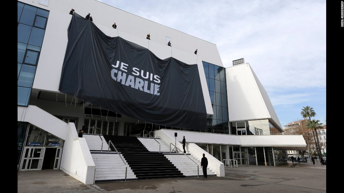 Workers install a giant banner on the Cannes Festival Palace in Cannes, France, on January 9.