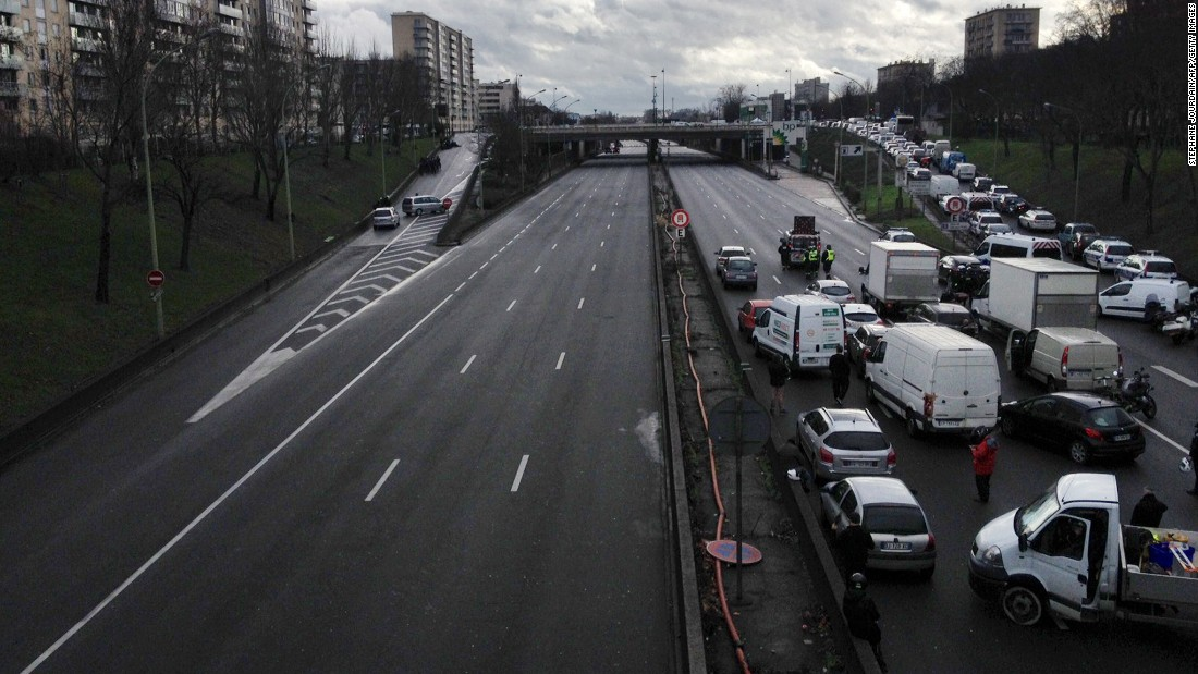 Vehicles are blocked on a road in Paris.