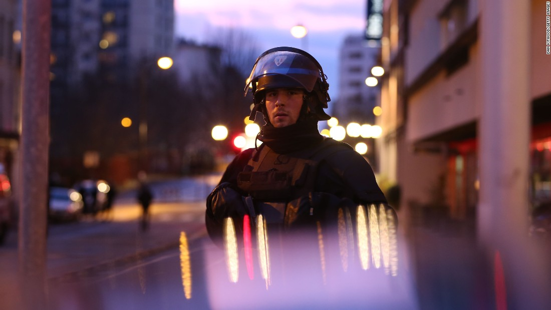 A police officer is seen at the scene of the standoff. Police union spokesman Pascal Disand said the hostage-taker, Amedy Coulibaly, demanded freedom for Cherif and Said Kouachi, the suspects in Wednesday's massacre at the Charlie Hebdo magazine office in Paris, who were simultaneously involved in a standoff wiith police northeast of Paris. Disand said the brothers and Coulibaly were part of the same jihadist groups.