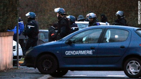 Police officers leave after storming the building in Dammartin-en-Goele.