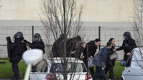 French police special forces evacuate local residents in Saint-Mande, near Porte de Vincennes, eastern Paris.
