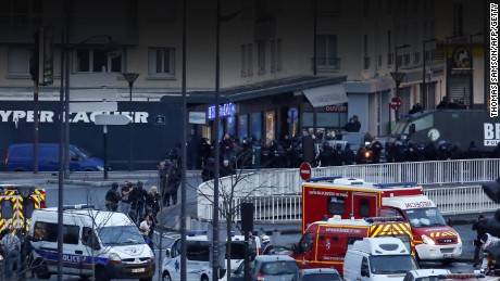 Caption:Members of the French police special forces launch the assault and evacuate the hostages at a kosher grocery store in Porte de Vincennes, eastern Paris, on January 9, 2015 where at least two people were shot dead on January 9 during a hostage-taking drama at a Jewish supermarket in eastern Paris, and five people were being held, official sources told AFP. AFP PHOTO / THOMAS SAMSON (Photo credit should read THOMAS SAMSON/AFP/Getty Images)