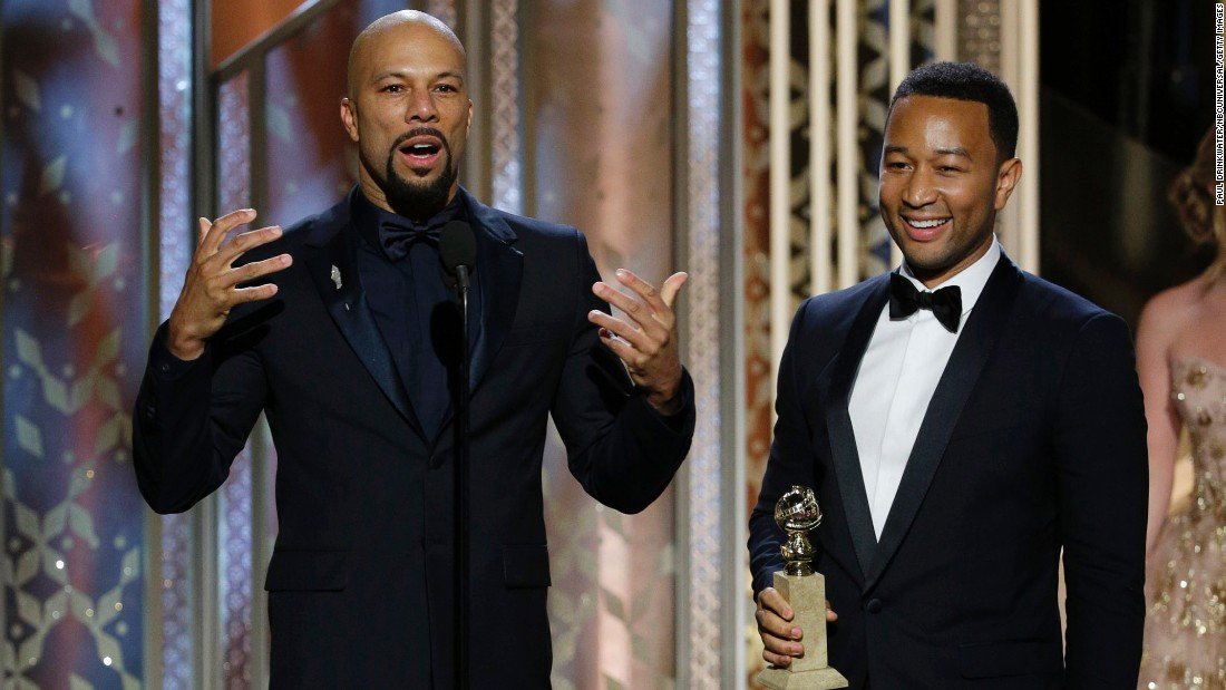 """Common, left, and John Legend accept the award for their song """"Glory"""" from the movie """"Selma."""""""