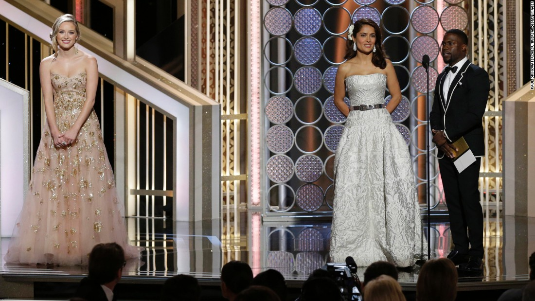 """Salma Hayek and Kevin Hart, at right, present the award for best animated film, which went to """"How to Train Your Dragon 2."""""""