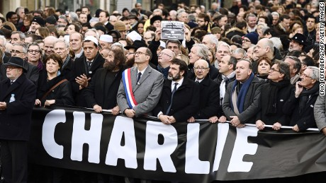 Samuel Sandler, father and grandfather of three of the victims of Islamist gunman Mohamed Merah, the Mayor of Lille and Socialist Party member Martine Aubry, Hassen Chalghoumi, Imam of the northern Paris suburb of Drancy and president of the French Association of Imams, French writer Marek Halter, UMP right-wing party member Eric Woerth and Joel Mergui, president of the Central Jewish Consistory of France and Pierre Gattaz (3rdR), head of the French employers' association (MEDEF) (5thR) take part in a Unity rally Marche Republicaine in Paris on January 11, 2015 in tribute to the 17 victims of a three-day killing spree by homegrown Islamists.