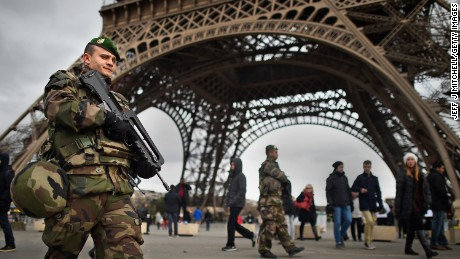 French troops patrol around the Eifel Tower on January 12, 2015 in Paris, France. France is set to deploy 10,000 troops to boost security following last week's deadly attacks while also mobilizing thousands of police to patrol Jewish schools and synagogues.