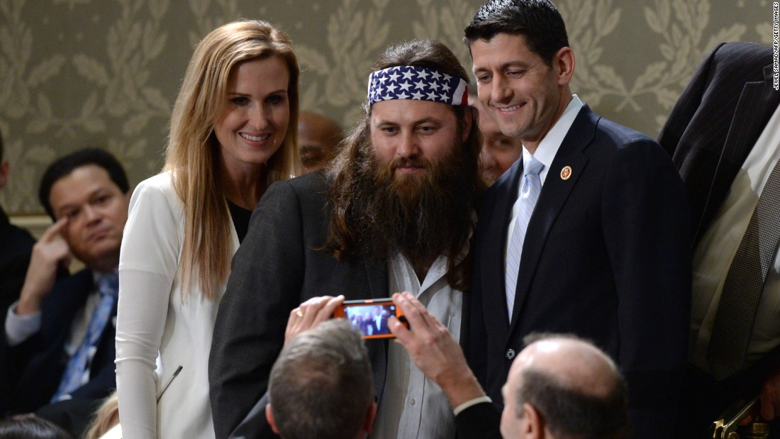 "Willie Robertson of the reality TV series ""Duck Dynasty"" poses for a picture with Ryan and his wife, Janna, before President Obama delivers his State of the Union address on January 28, 2014."