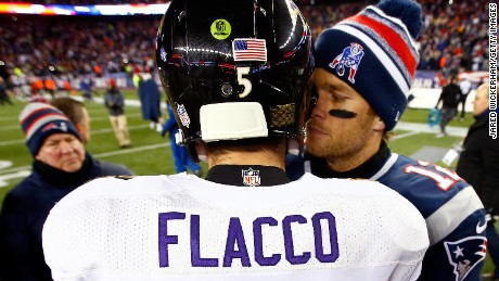 Joe Flacco #5 of the Baltimore Ravens and  Tom Brady #12 of the New England Patriots hug following the 2015 AFC Divisional Playoffs game at Gillette Stadium on January 10, 2015 in Foxboro, Massachusetts.