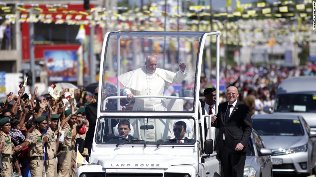 Pope Francis waves to people on the outskirts of Colombo on January 13.