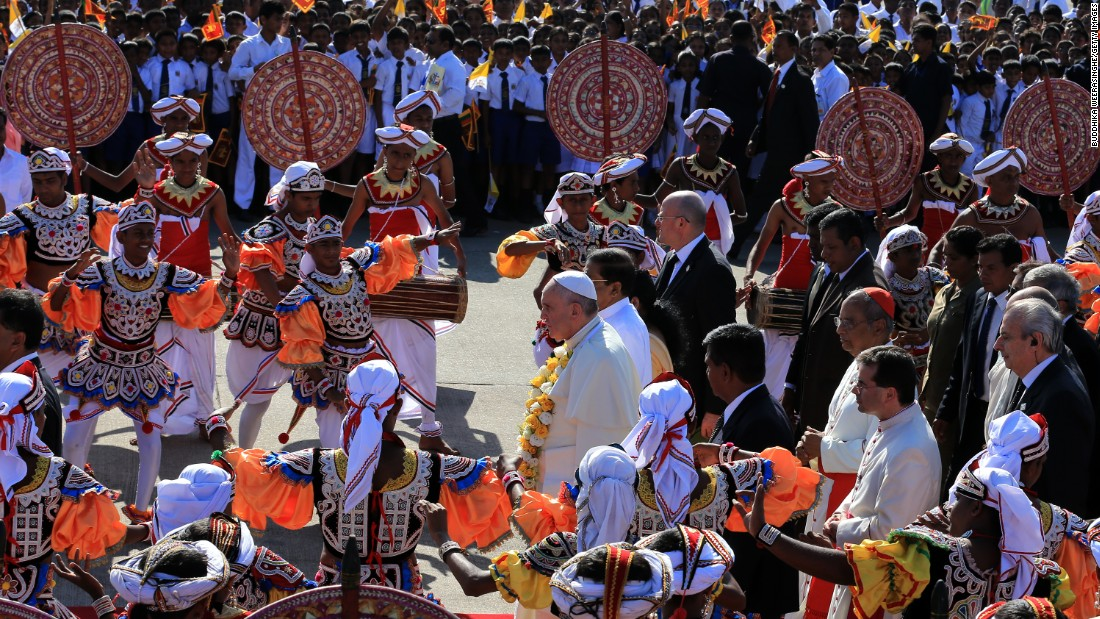 Pope Francis is welcomed in a ceremony at the airport.