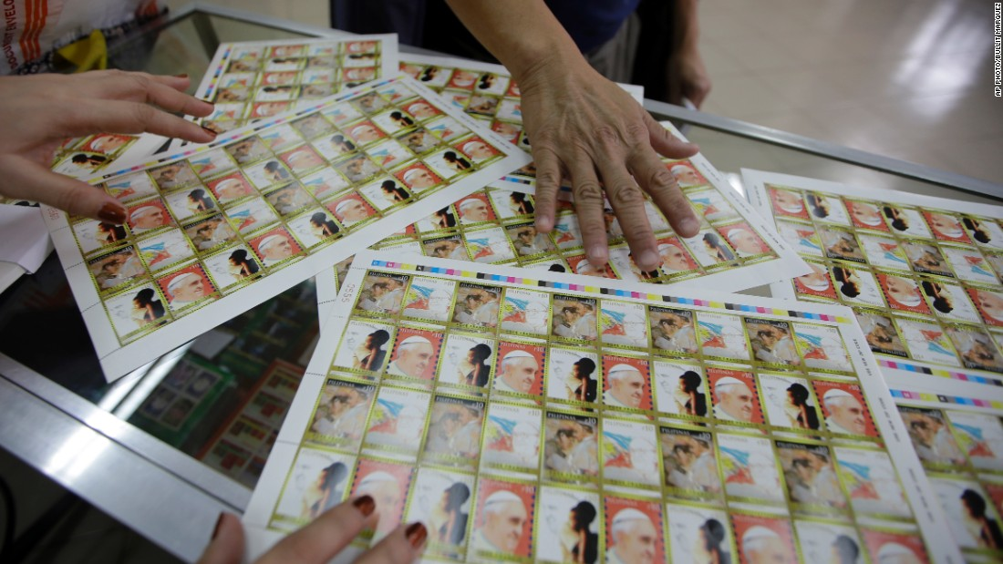 Filipinos buy commemorative stamps featuring Pope Francis on January 8. They were released as a tribute to the pontiff who will visit the predominantly Catholic nation from January 15 - 19.