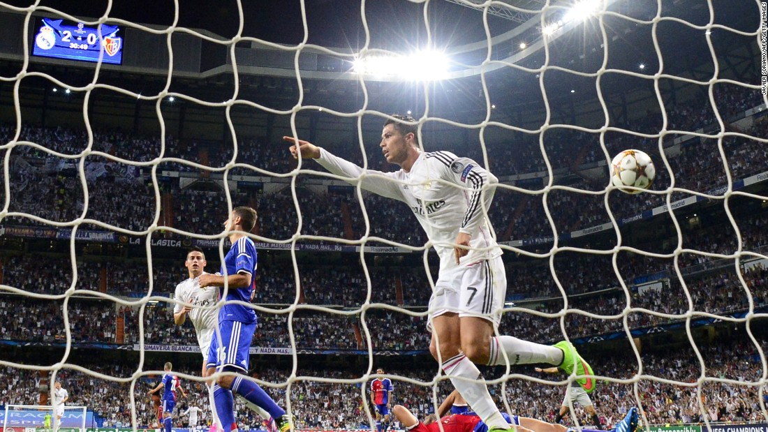 September 16: Ronaldo celebrates after scoring Madrid's third goal during the team's opening of its Champions League defense against Basel 1893.