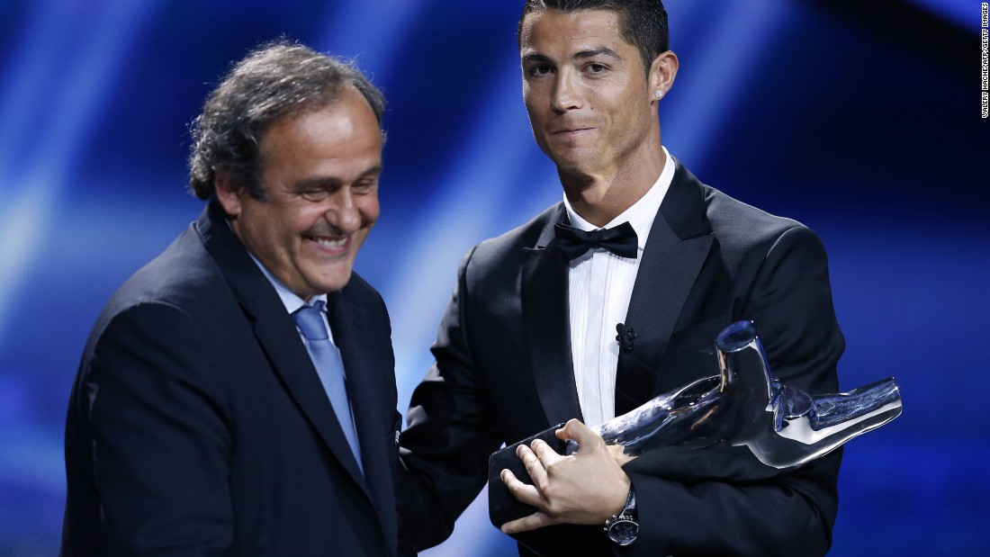 August 28: Ronaldo is congratulated by UEFA head Michel Platini as he wins the UEFA European Player of the Year trophy.