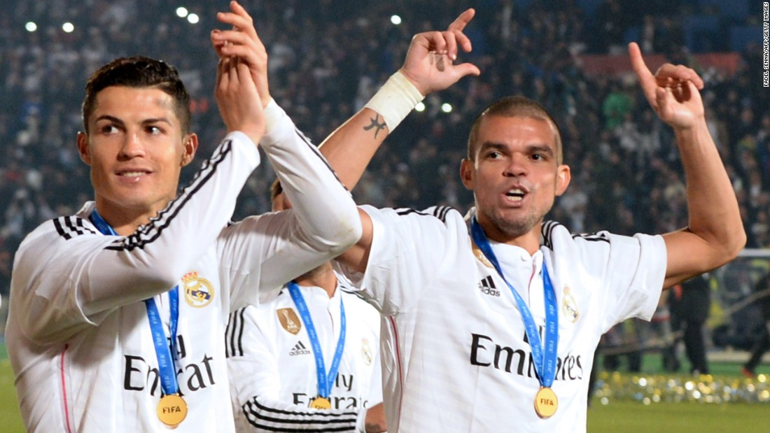 December 20: Ronaldo (L) and compatriot and teammate Pepe (R) salute their supporters after winning the FIFA Club World Cup final match against San Lorenzo in Morocco to cap off a hugely successful 2014.