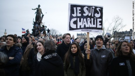 People holding cardboards reading 'Je suis Charlie (I am Charlie) take part in a Unity rally Marche Republicaine on the Place de la Nation (Nation Square) in Paris on January 11, 2015 in tribute to the 17 victims of a three-day killing spree by homegrown Islamists. The killings began on January 7 with an assault on the Charlie Hebdo satirical magazine in Paris that saw two brothers massacre 12 people including some of the country's best-known cartoonists, the killing of a policewoman and the storming of a Jewish supermarket on the eastern fringes of the capital which killed 4 local residents. AFP PHOTO / THOMAS SAMSON (Photo credit should read THOMAS SAMSON/AFP/Getty Images)