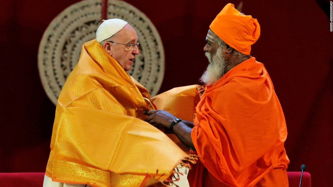 Hindu priest Kurakkal Somasundaram presents a shawl to Pope Francis during a meeting in Colombo on Tuesday, January 13.