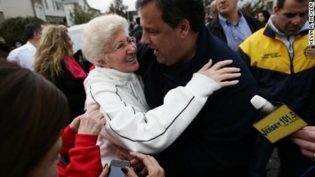 New Jersey Gov. Chris Christie (R) hugs Angela Cimillo of Moonachie