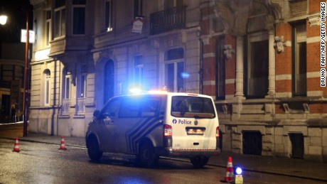"Police set a large security perimeter around 6 Colline street in the city center of Verviers, eastern Belgium, where three people were reportedly killed in an anti-terrorism operation on January 15, 2015. Belgian police launched a ""jihadist-related"" anti-terrorism operation in the eastern town of Verviers on January 15, with reports saying there were three deaths. Public broadcaster RTBF reported three deaths and said explosions were heard at the scene, but there was no immediate confirmation. The incident comes as Europe is on high alert after 17 people were killed in the Islamist attacks on the Charlie Hebdo magazine and a Jewish supermarket in Paris last week. AFP PHOTO / BELGA / BRUNO FAHY --BELGIUM OUT--        (Photo credit should read BRUNO FAHY/AFP/Getty Images)"