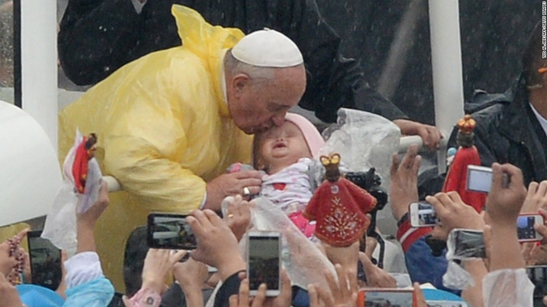 Pope Francis kisses a child on January 18 in Manila.
