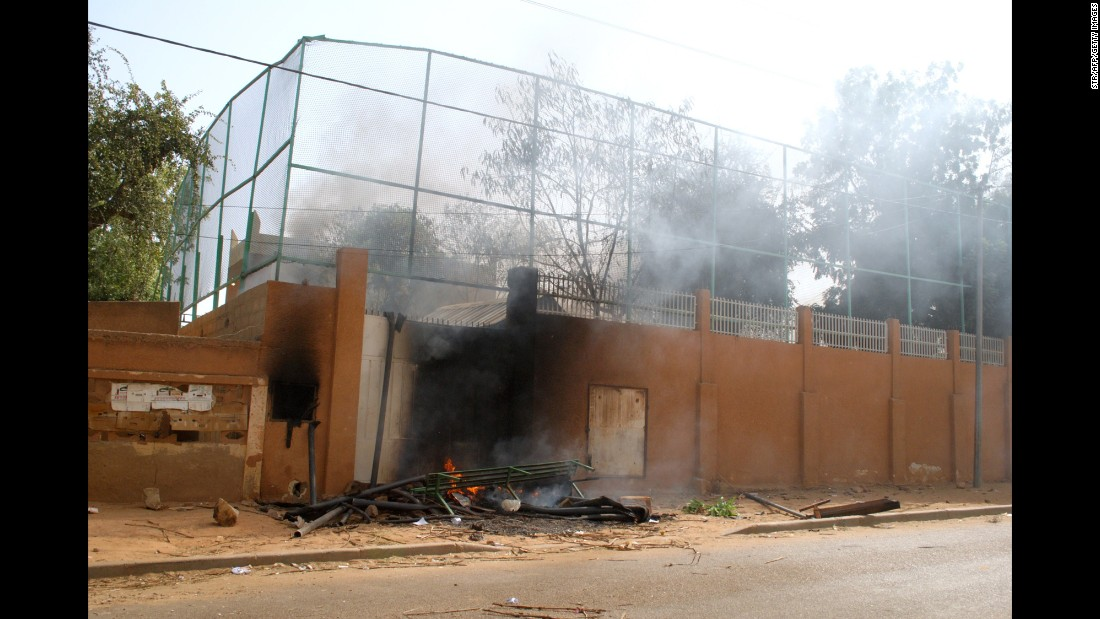 Smoke rises from the Franco-Nigerien Cultural Center in Zinder after it was burned down by protesters on January 16.