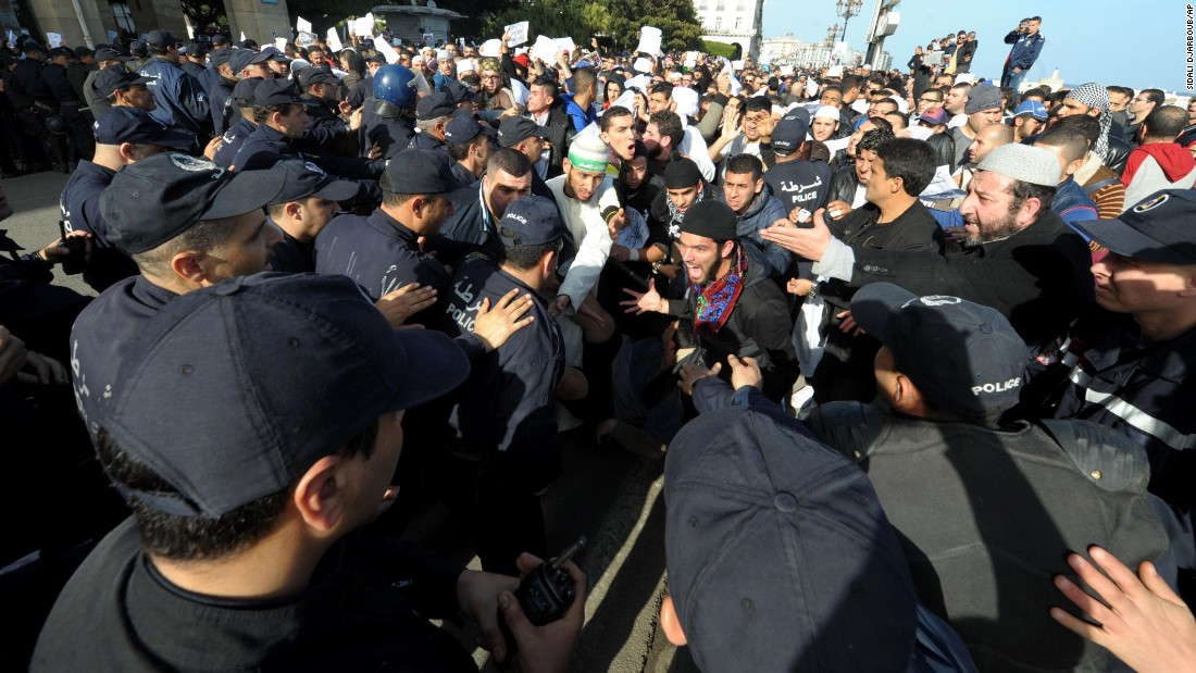 Protesters clash with police officers in Algiers, Algeria, on January 16.