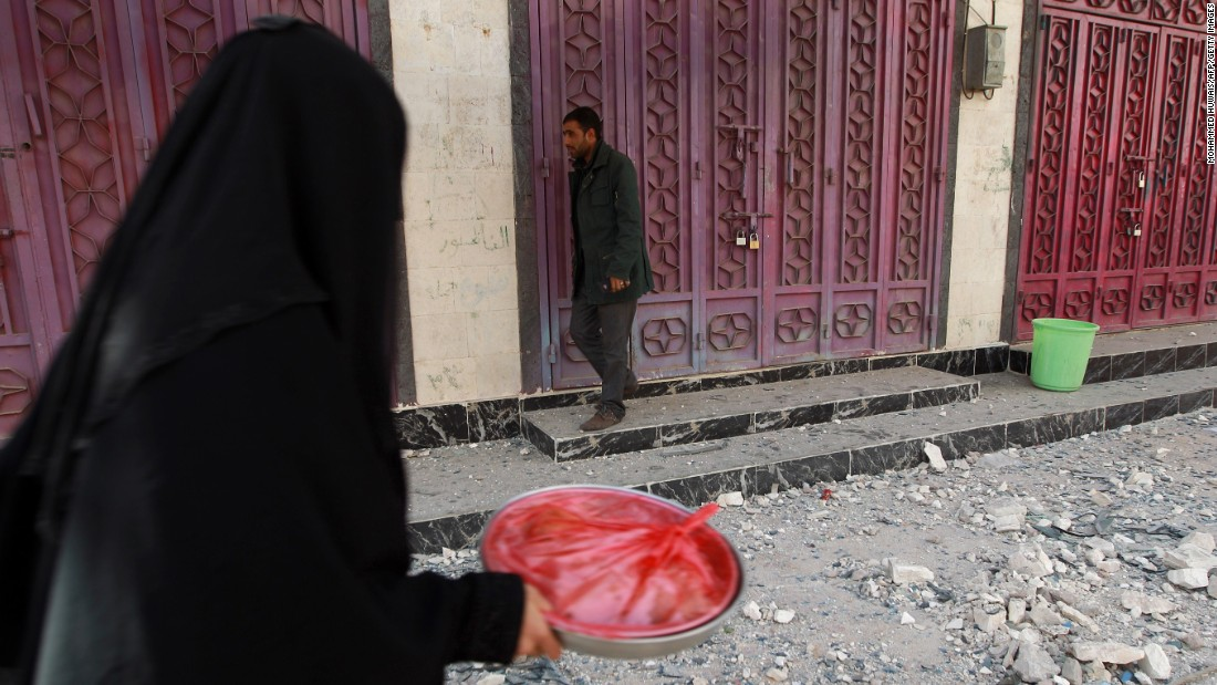 A woman walks past closed shops in Sanaa on January 20.