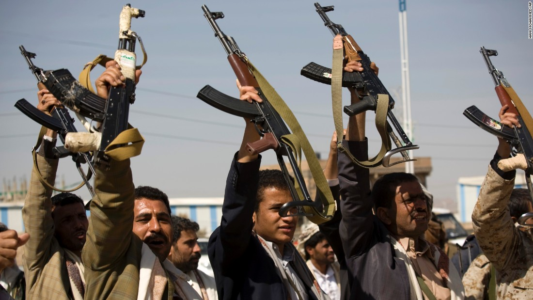 Houthi men raise their weapons during clashes near the presidential palace in Sanaa on Monday, January 19. Nine people were killed and 67 others were injured in the fighting between government forces and Houthi militants on Monday before the sides agreed to a ceasefire, Yemen's Health Ministry said.