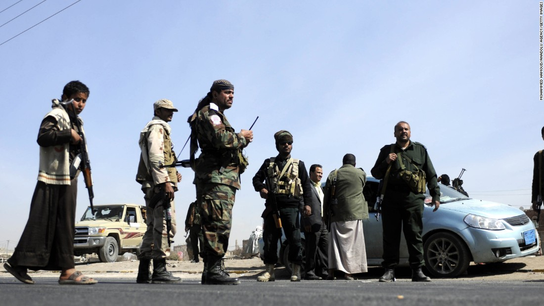 Armed Houthis gather at Sebin Square as they close the road to traffic near the presidential palace in Sanaa on January 19.