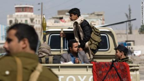 Houthi men guard a Sanaa street on January 19.