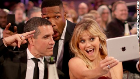 (L-R) Jim Toth, host Michael Strahan and actress Reese Witherspoon pose for selfies during the 20th annual Critics' Choice Movie Awards at the Hollywood Palladium on January 15, 2015 in Los Angeles, California.