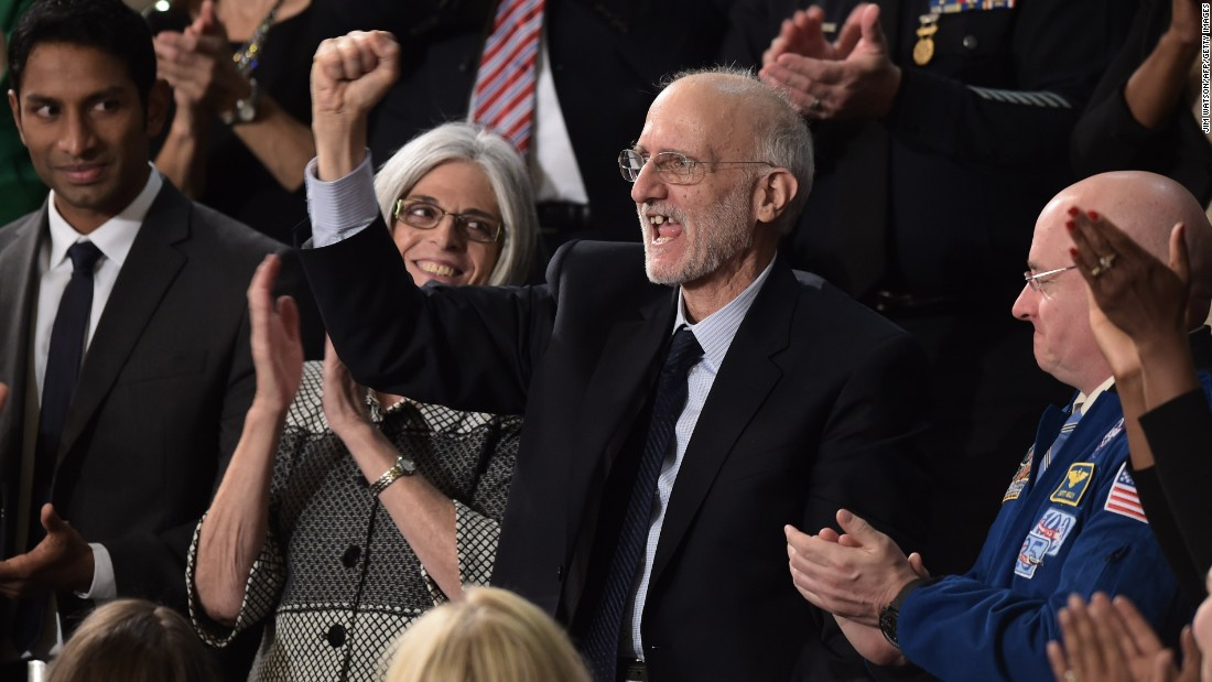 Alan Gross, center, a U.S. contractor released from prison in Cuba last month, is applauded during the speech.
