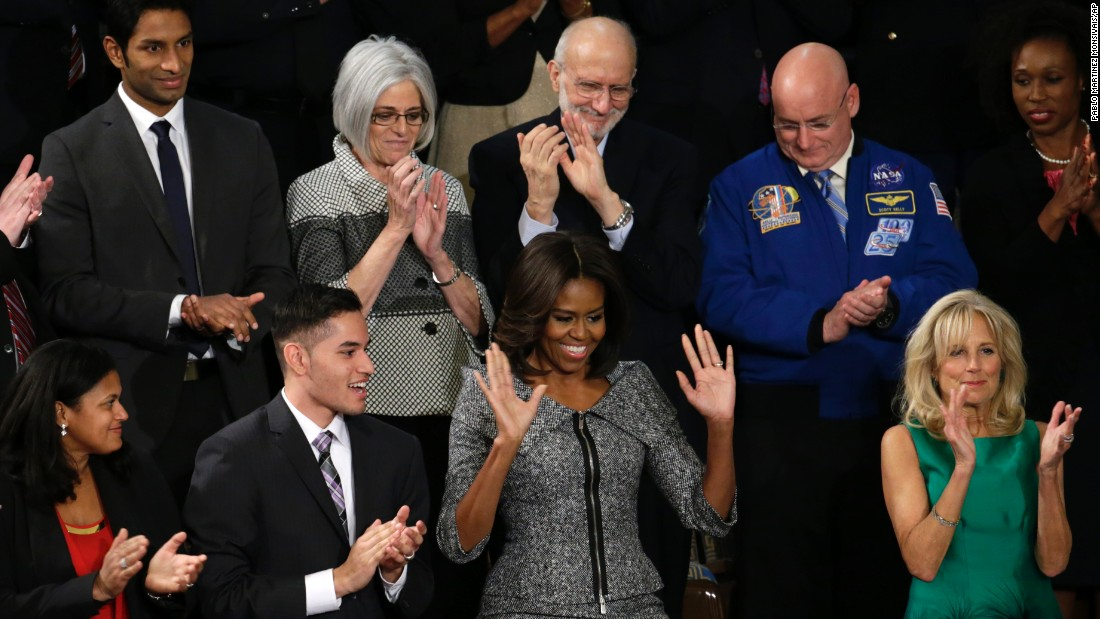 First lady Michelle Obama, center, arrives for the State of the Union address. At right is Dr. Jill Biden, wife of Vice President Joe Biden.