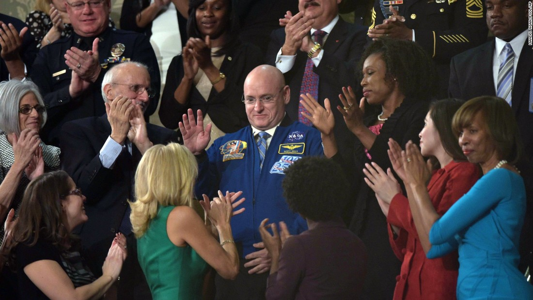 NASA astronaut Scott Kelly, center, is recognized by Obama during the speech. Kelly is preparing to spend a year on the International Space Station.